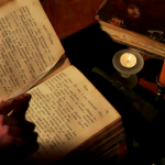 videoblocks-reading-old-book-under-candlelight-monk-reads-the-old-liturgical-book-in-the-monastery-cell-under-candlelight_hlmfxigvil_thumbnail-full01